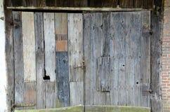 Vecchio portone di legno Fotografie Stock