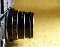 Vecchio primo piano nero dell'obiettivo Fotografia Stock