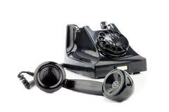 Vecchio retro telefono della bachelite Su una priorità bassa bianca Fotografia Stock Libera da Diritti