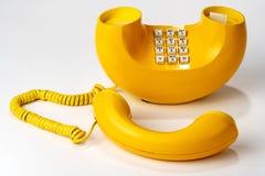 Vecchio retro telefono, giallo, dialer del pulsante Fotografia Stock
