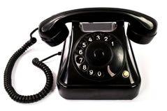 Vecchio retro telefono nero isolato su un fondo bianco fotografie stock