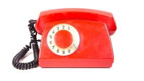 Vecchio retro telefono rosso e sudicio senza bottoni Immagini Stock Libere da Diritti