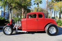 Vecchio rosso - caldo - automobile della barretta Fotografia Stock