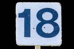 Vecchio segno bianco con il numero 18 Fotografie Stock