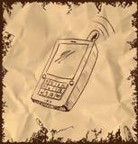 Vecchio telefono cellulare su fondo d'annata Immagine Stock Libera da Diritti