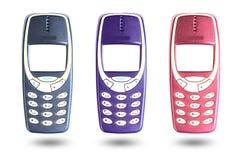 Vecchio telefono cellulare su un fondo bianco Fotografie Stock