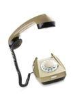 Vecchio telefono con il microtelefono sollevato fotografia stock