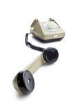 Vecchio telefono con il microtelefono sollevato fotografia stock libera da diritti