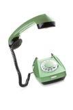 Vecchio telefono con il microtelefono sollevato fotografie stock