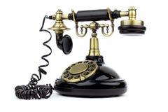 Vecchio telefono del nero dell'annata Immagine Stock