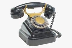 Vecchio telefono del nero dell'annata con le manopole del disco Immagine Stock