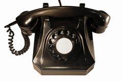 Vecchio telefono della bachelite con il quadrante classico Isolato su priorità bassa bianca immagini stock