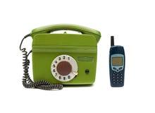 Vecchio telefono due su una priorità bassa bianca Fotografie Stock Libere da Diritti