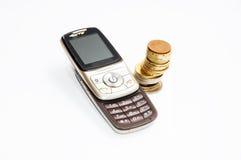 Vecchio telefono e la moneta europea Immagine Stock