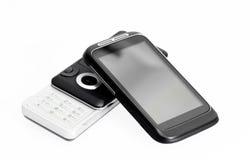 Vecchio telefono e nuovo smartphone Fotografia Stock