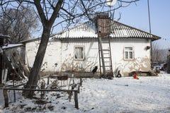 Vecchio tempo di inverno e della casa Fotografie Stock