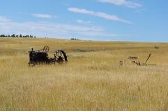 Vecchio trattore in un campo Fotografia Stock