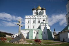 Veche area. Near the walls of Trinity Cathedral in Pskov Kremlin and the memorial cross to the 1100th anniversary of Pskov Stock Photography