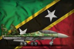 Vechter, interceptor met boscamouflage op de de vlagachtergrond van de staat van St.Kitts.en.Nevis 3D Illustratie stock illustratie