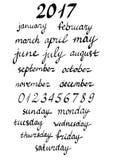 Veckadagar och månader namn som märker, räcker skriftlig kalligrafi Arkivfoton