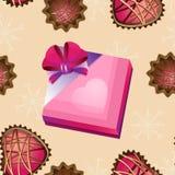 Vecteur sans couture avec un boîte-cadeau et des petits gâteaux Photographie stock libre de droits