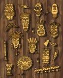 Vecteur tribal de masque réglé sur le fond en bois Image libre de droits