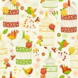 Vector безшовная картина с птицами, birdcages и цветками иллюстрация штока