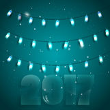 Vector иллюстрация к рождеству с яркими светами на голубой предпосылке Стоковое Фото