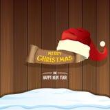 Vector красная шляпа Санты с бумажным знаменем и Новый Год текста приветствию с Рождеством Христовым и счастливый на деревянной п Стоковая Фотография