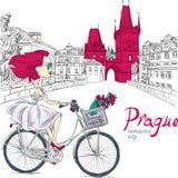 Vector милая девушка на велосипеде в Праге иллюстрация штока