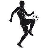 Vector силуэт игрока футбола (футбола) с ба Стоковые Фото