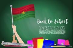Vector флаг Буркина Фасо на черной предпосылке доски Предпосылка образования с задерживать рук флага Буркина Фасо вакханические иллюстрация вектора