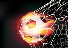 Vector футбольный мяч в сети цели на пламенах огня Стоковое фото RF