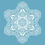 Vector six-pointed Christmas snowflake on a light blue background royalty free stock images