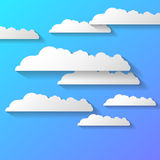 Vector abstract background composed of white paper clouds over blue. Eps10. Royalty Free Stock Photos