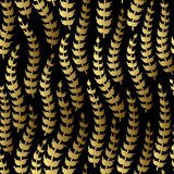 Vector abstract floral seamless pattern. Golden branch on black background. Royalty Free Stock Image