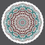 Vector abstract floral twelve-pointed mandala on a grey background. royalty free illustration