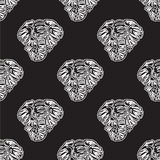 Vector abstract seamless background of heads of elephants. White on black Royalty Free Illustration