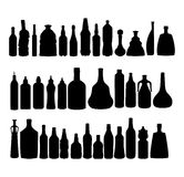 Vector alcohol bottles silhouettes. Royalty Free Stock Photos