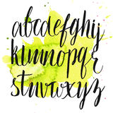 Vector alphabet at green watercolor splash stock illustration