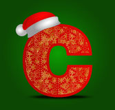 Vector alphabet letter C with christmas hat and gold snowflakes Royalty Free Stock Images
