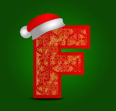 Vector alphabet letter F with christmas hat and gold snowflakes Stock Photo
