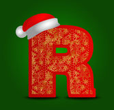 Vector alphabet letter R with christmas hat and gold snowflakes Stock Image