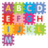 Vector alphabet from A to M written with puzzle. Alphabet from A to M written with puzzle -  illustration Royalty Free Stock Image