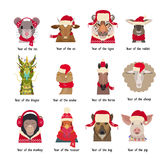 Vector animal Heads in red caps scarfs. Chinese horoscope symbols. Vector animal Heads in red caps and scarfs of the Chinese horoscope . Vector cartoon,flat Stock Photos