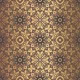 Golden Arabesque Pattern. Vector arabesque pattern. Seamless flourish background with golden floral elements. Intricate ornate lines. Arabic decorative design Stock Photography