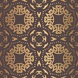 Golden Arabesque Pattern. Vector arabesque pattern. Seamless flourish mandala background with golden floral elements. Intricate ornate lines. Arabic decorative Royalty Free Stock Image