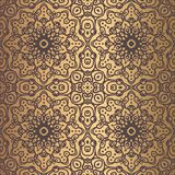 Golden Arabesque Pattern. Vector arabesque pattern. Seamless flourish mandala background with golden floral elements. Intricate ornate lines. Arabic decorative Royalty Free Stock Photography
