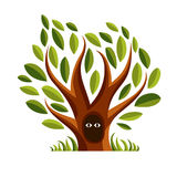 Vector art illustration of branchy tree with den. Two eyes of an Royalty Free Stock Photography