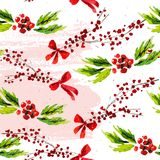 Vector artistic seamless pattern for Merry Christmas holiday with hand drawn watercolor decor elements - holly berry branch, red b. Ow isolated on white Royalty Free Stock Images